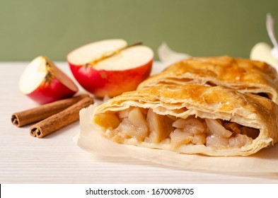 Apple strudel on a table. Homemade pastries.