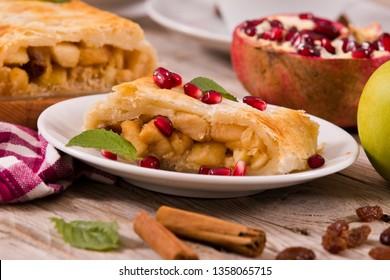 Apple strudel on white dish.