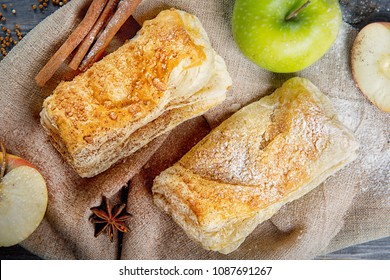 Apple strudel on a wooden table. Advertising still life from baking.