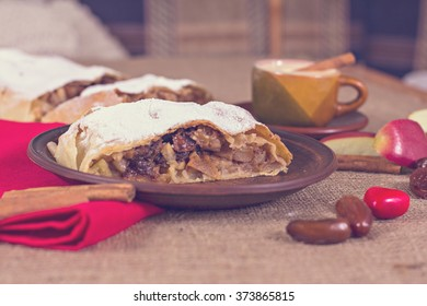 Apple strudel, apple pie and a cup of coffee. The atmosphere for a cozy romantic evening. Valentine's day.