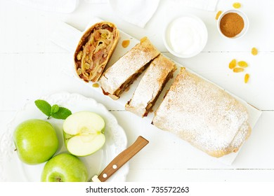 Apple strudel with raisins and almonds. view from above.