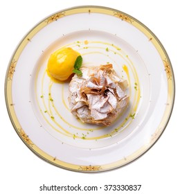 apple strudel with raspberry ice cream and a sprig of mint, isolated, restaurant supply