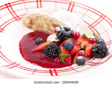 Apple strudel with sauce from fresh berries