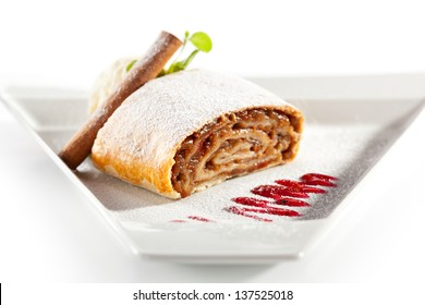 Apple Strudel Served with Ice Cream and Fresh Mint
