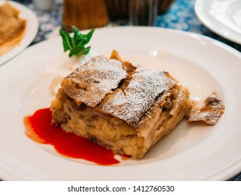 Apple strudel with Strawberry Sauce and Whip Cream Baked Bakery on White Plate