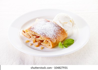 Apple strudel with vanilla ice cream and mint