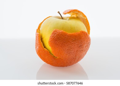 Apple in a tangerine peel