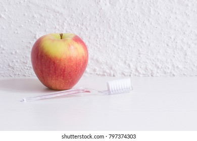 apple and toothbrush