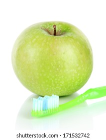 Apple with a toothbrush isolated on white