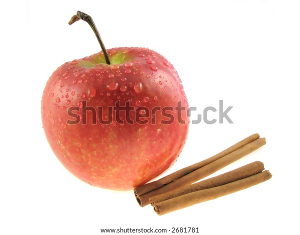 Apple  and two sticks  of cinnamon