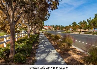 Apple Valley, CA / USA – November 13, 2019: Street view during autumn on Apple Valley Road in the Town of Apple Valley, California.