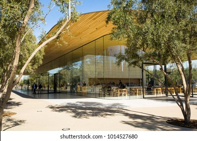 Apple Visitor Center, 1 Apple Park Way, San Jose, California, United States (USA) - January 30, 2017: Guests arrive at the Visitor Centre, a glass and wood building  housing Apple store and cafeteria