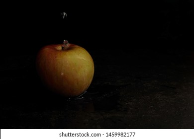 Apple with water drops in high definition, black background, Caravaggio style