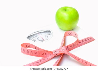 apple and weight scale with measuring tape.Conception about health care, selective focus