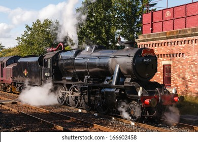 APPLEBY, ENGLAND - AUGUST 18:  Preserved Stanier Class 8F steam locomotive number 48151 pictured in Appleby, England on August 18, 2013, on the Settle to Carlisle railway.