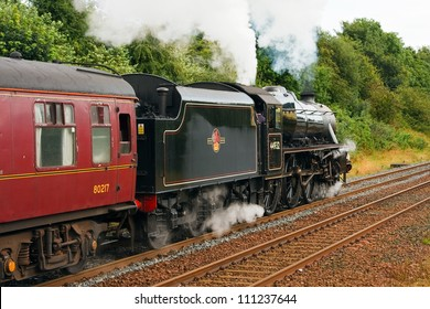 APPLEBY, ENGLAND - AUGUST 26:  Preserved Stanier Class Black Five steam locomotive number 44932 pictured in Appleby, England on August 26, 2012, on the Settle to Carlisle railway.