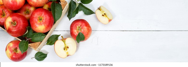 Apples apple fruits fruit with leaves from above banner copyspace copy space wooden board wood