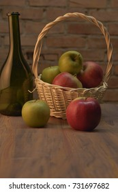 Apples in the basket and green glass