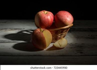 apples in a basket on a dark background