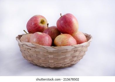 Apples in a basket on a white background.