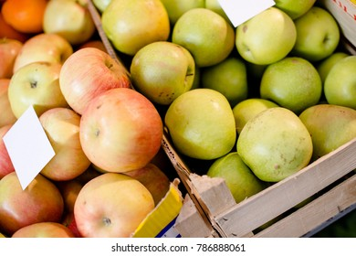 Apples are displayed for a sale at local market, green and red apples with price on them.