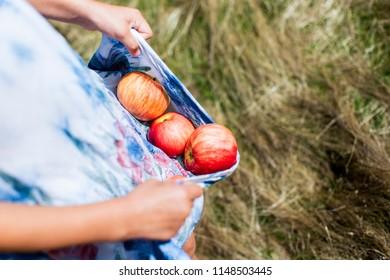 Apples falling of dress