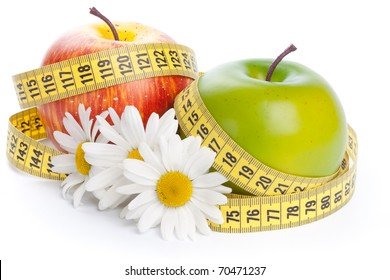 Apples, flowers and measuring tape. Concept of healthy food.
