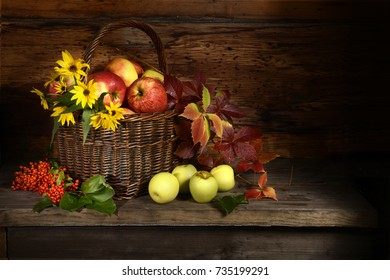Apples fruit autumn yellow red leaves berries vitamins basket wooden table still life