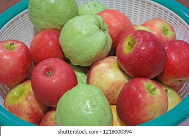 Apples and guava in a plastic basket.The fruit contains vitamin C and anti-oxidant.
