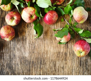 Apples with leaves on wooden background with copy space