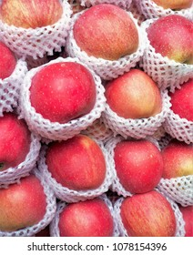 apples in a market stall