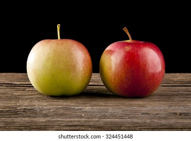 apples on a black background
