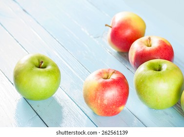 Apples on blue wood background