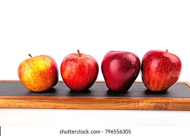 apples on a cutting board isolated on a white background