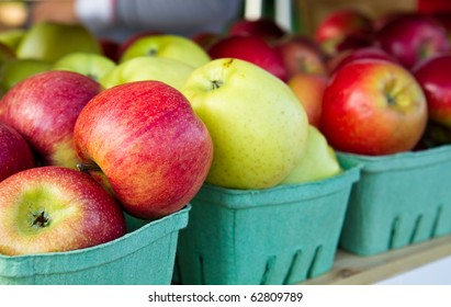 Apples on a shelf at a farmer's market