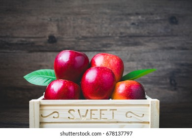 Apples on sweet box in vintage tone for happy day.