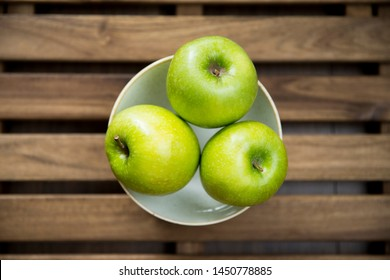 Apples on the table. Green apples background for texture.