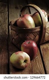 apples on wood deck