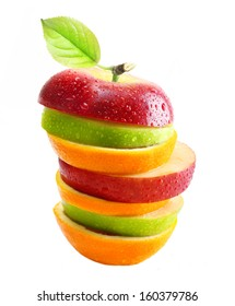 Apples and orange fruit with water drops isolated