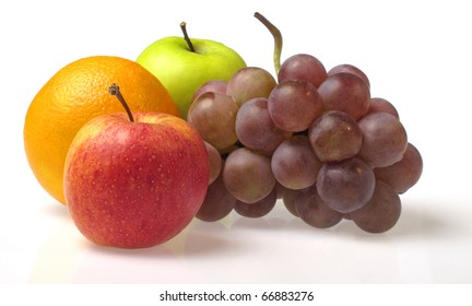 Apples, orange and grapes on white background