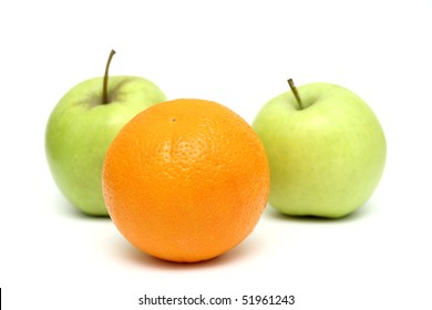 apples and oranges mixed, orange standing out from the crowd