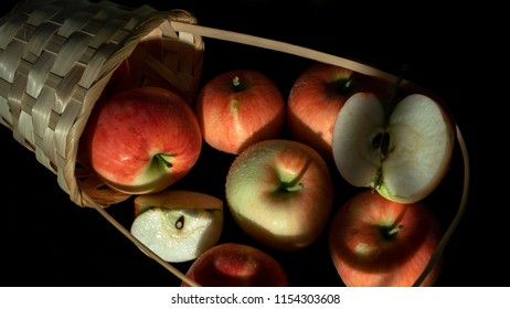 Apples and pannier, black background