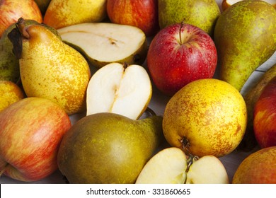 apples and pears whole and halved shot close-up