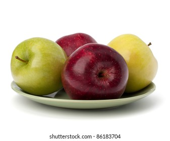 Apples pile on plate isolated on white background
