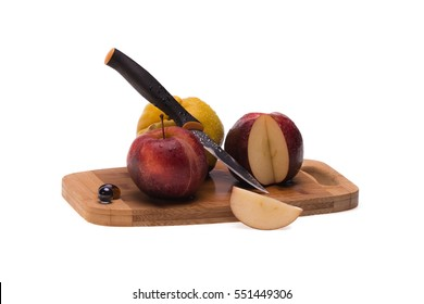 Apples and quince on the chopping board with knife
