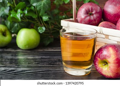 apples red and green Apple juice in a transparent glass on a natural background