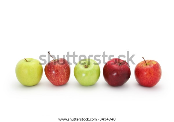 Apples in a row, isolated on white with natural shadow.  Includes golden delicious, red delicious, granny smith, fuji.