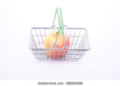 apples in a shopping basket on white background