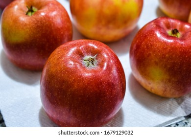 Apples sitting on a table
