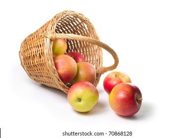 apples spilling out of a basket.